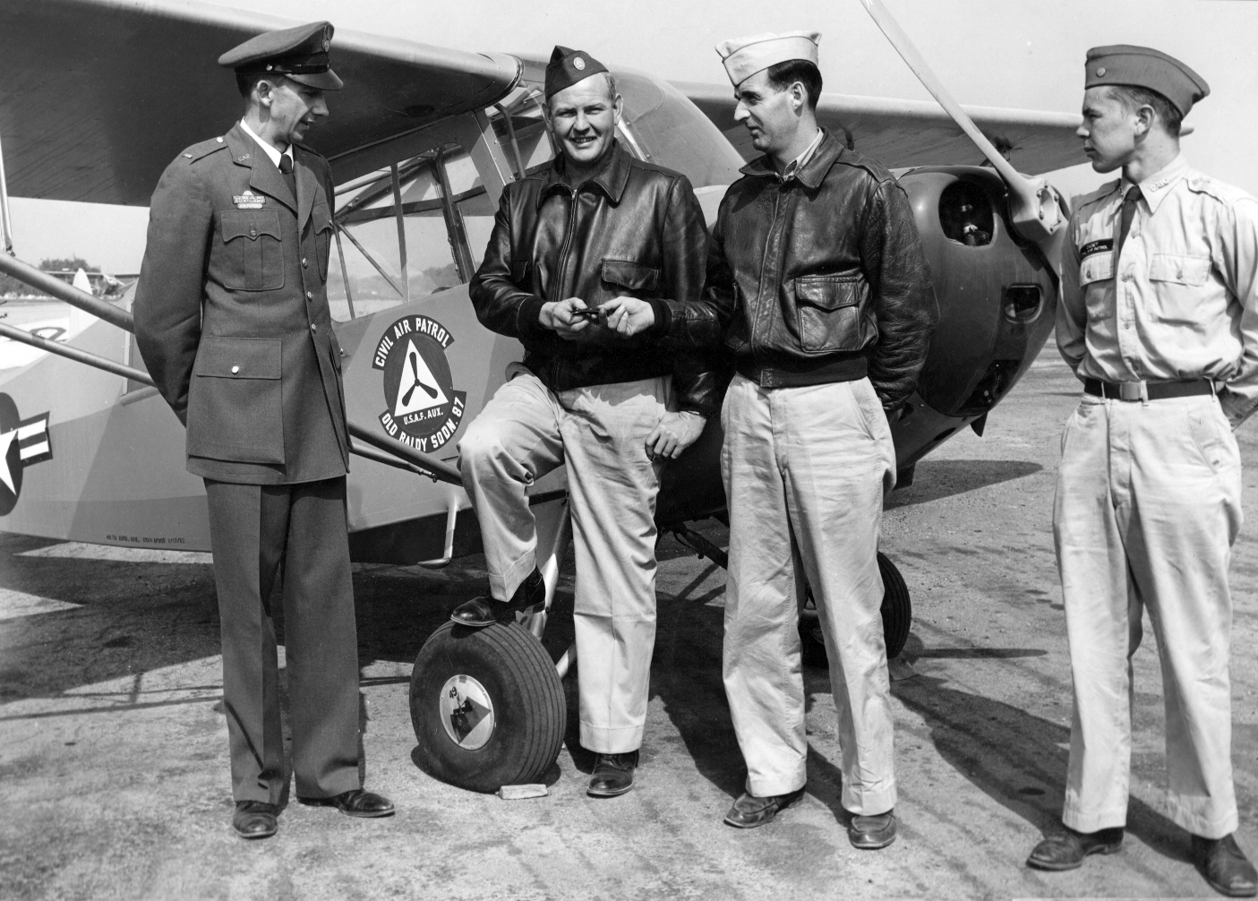 Squadron members in front of the newly issued L-16